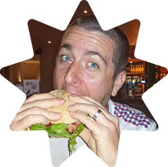 Stuart eating a burger
