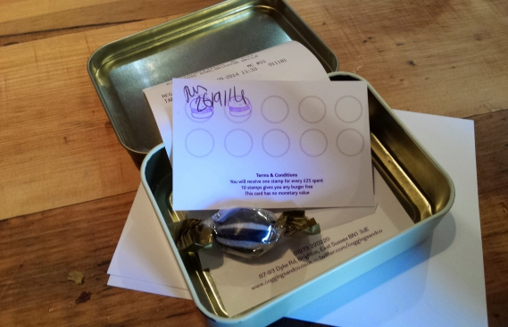 Our receipt and loyalty card in a old Gentlemans Choice tin
